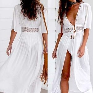 Stunningly Beautiful white bathing suit cover up.